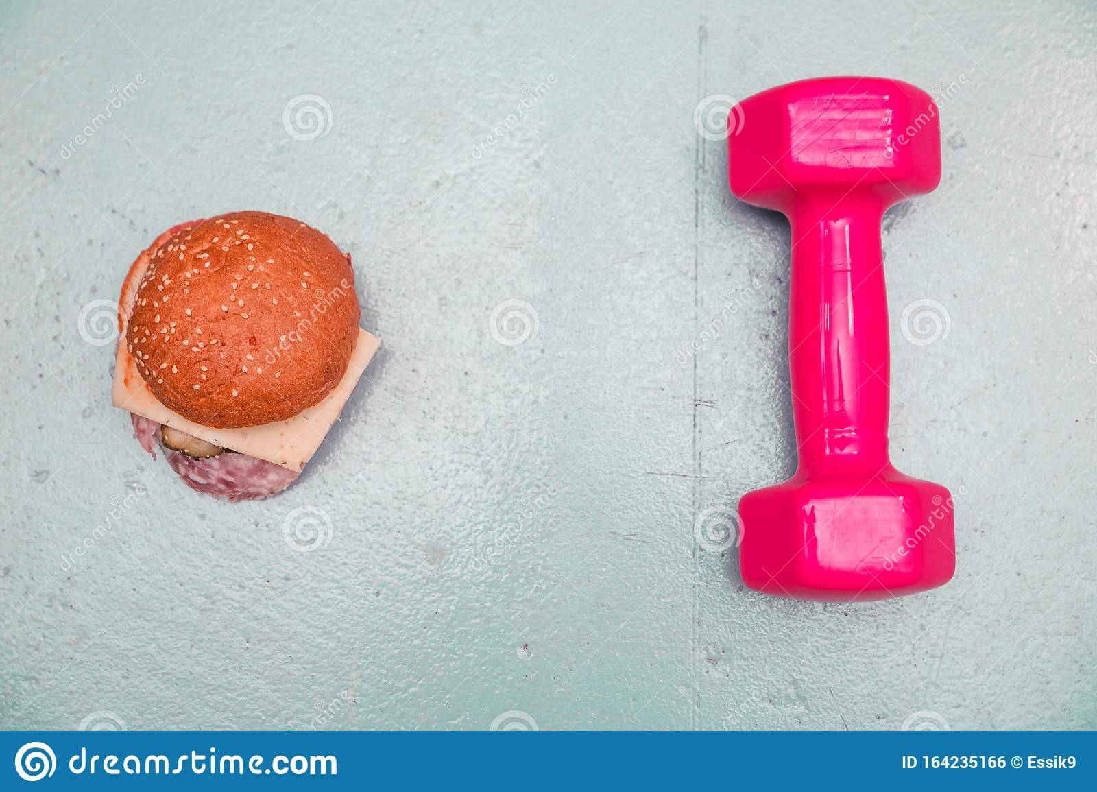 Sports Dumbbells And Fast Food On A Blue Background The