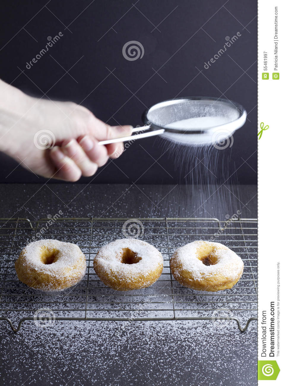 Sprinkling Sugar On 3 Ring Doughnuts Stock Photo Image