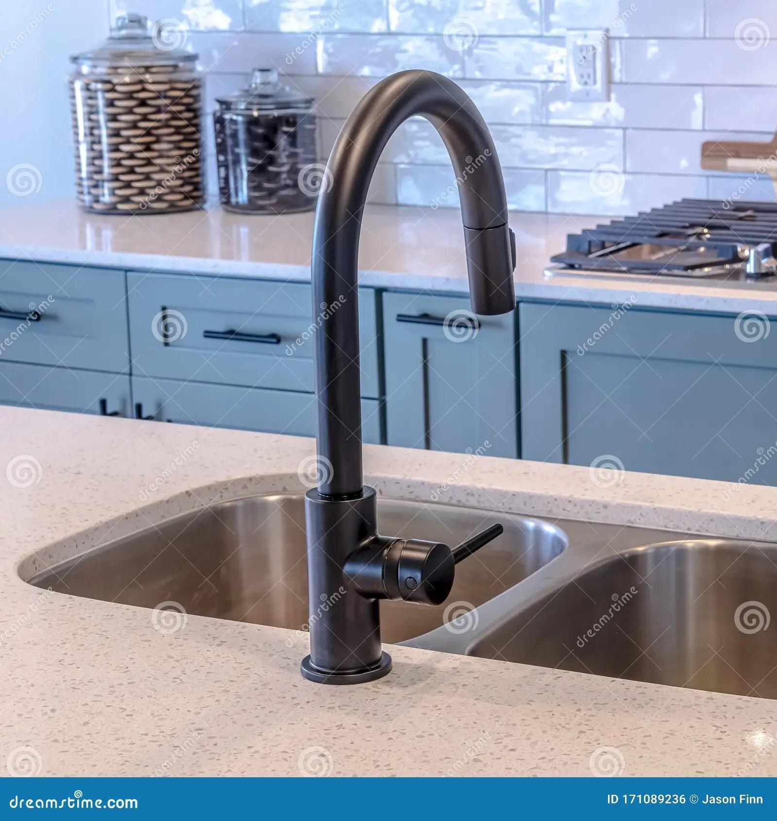 https www dreamstime com square kitchen island double sink black faucet against cooktop tile backsplash wooden cabinets handles can also be seen image171089236