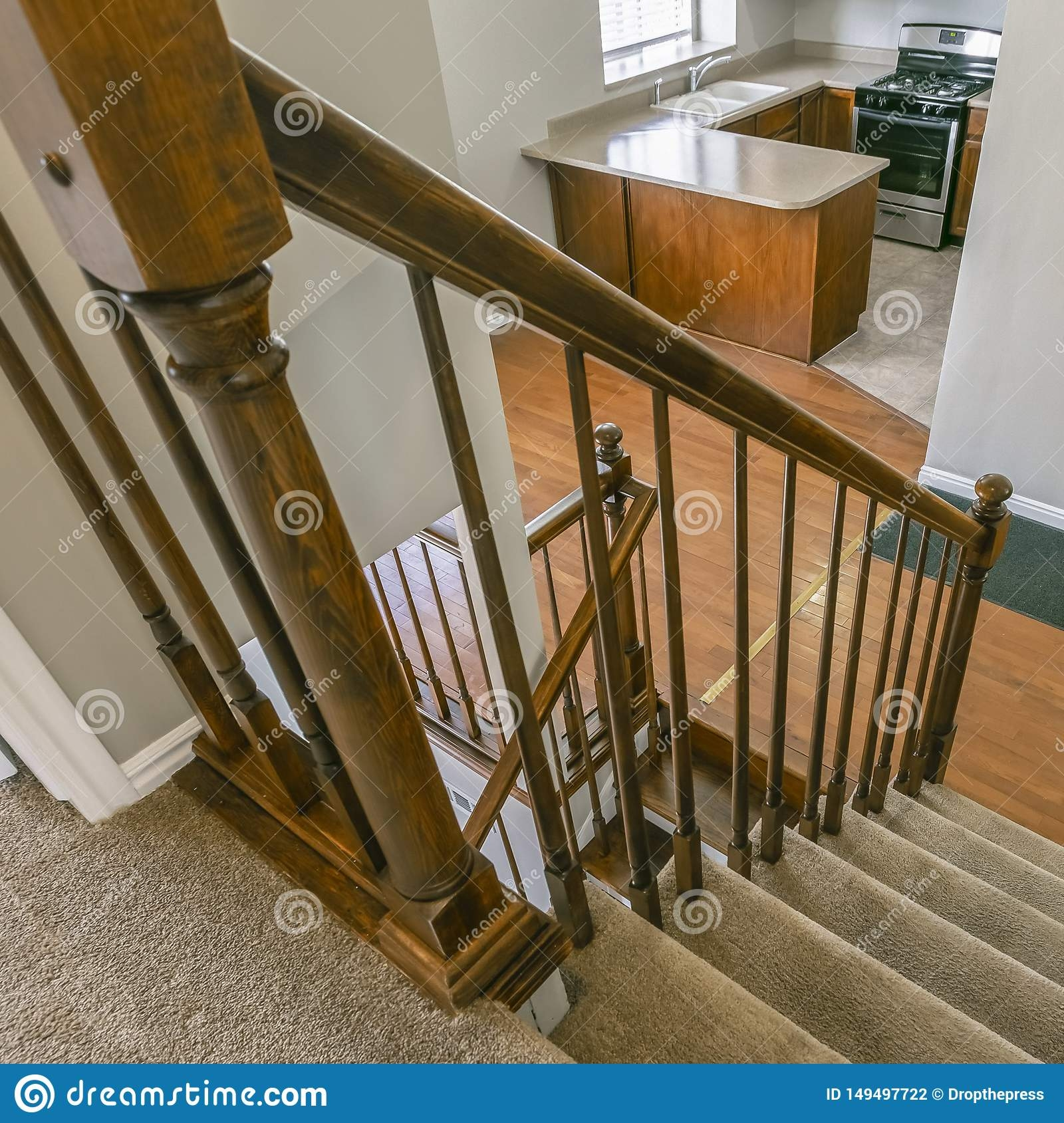 Square Staircase Inside A House Overlooking The Kitchen And An | Square Handrail For Stairs | Balustrade | Outdoor | Hand Rail | Low Cost | Residential
