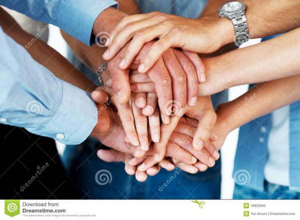 Stacked Hands Symbolizing Team Effort Stock Photo - Image ...