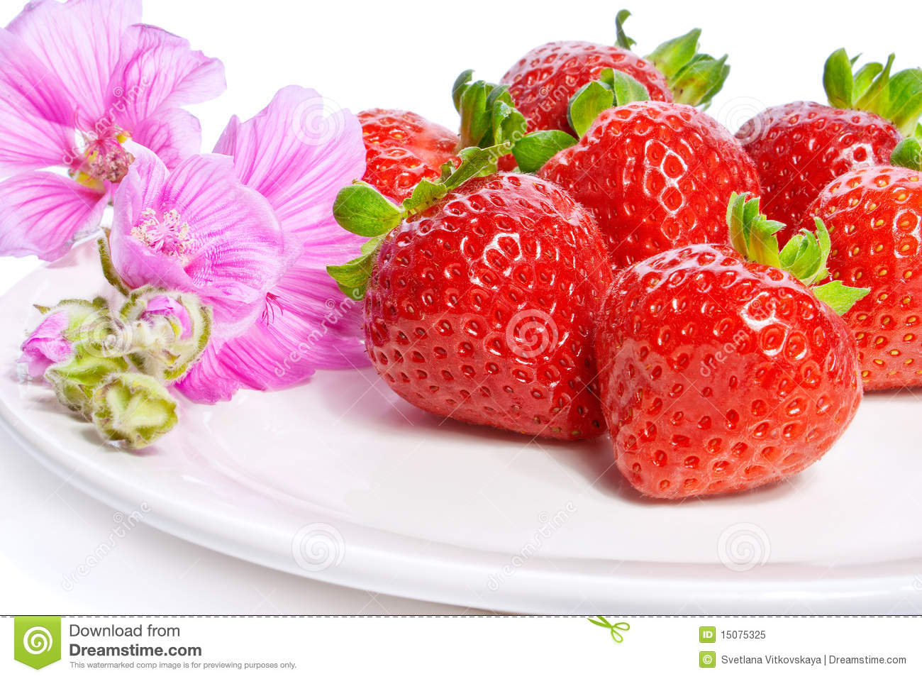Image of strawberries and flowers on a plate