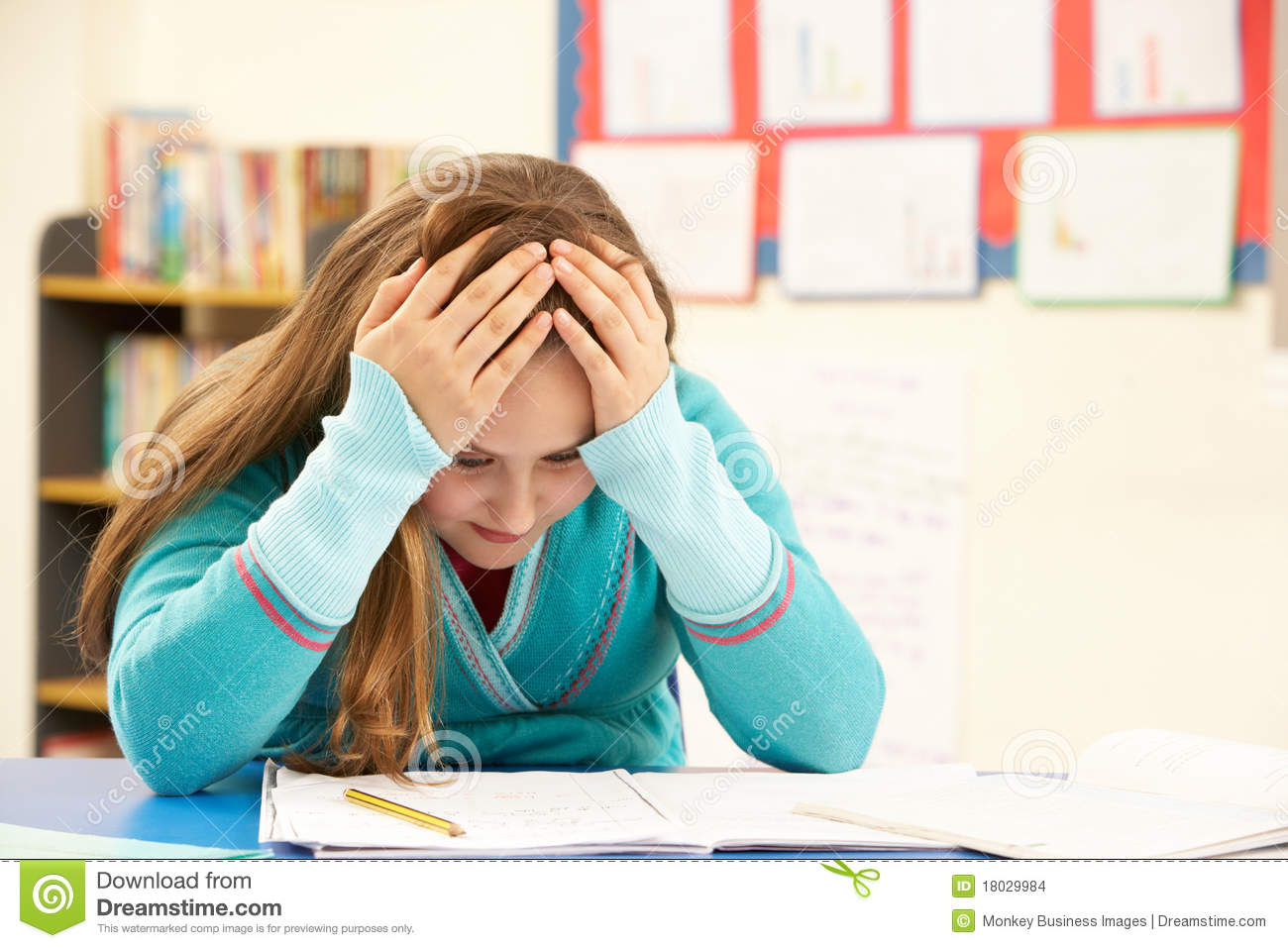 Stressed Schoolgirl Studying In Classroom Stock Images