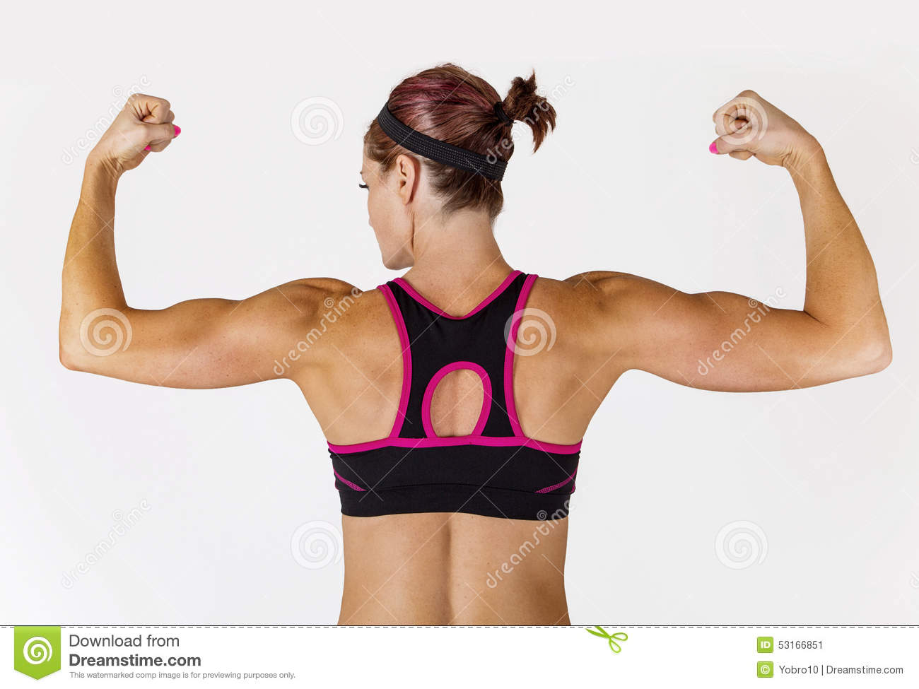Strong Beautiful Fitness Woman Flexing Her Arm And Back