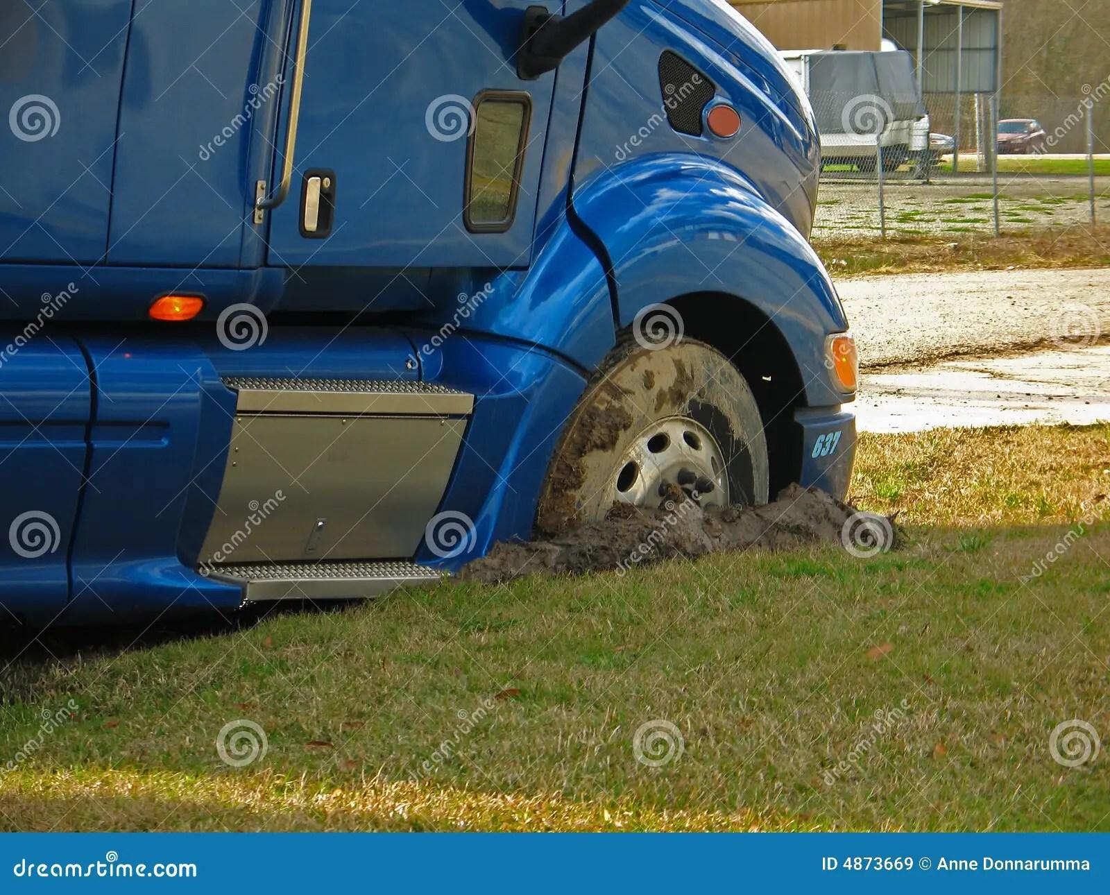 Blue Tractor Stuck Mud