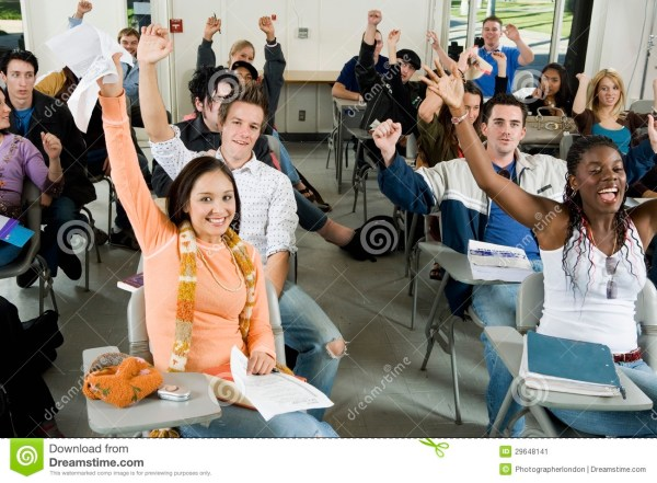 Students Raising Hands In The Classroom Stock Image ...