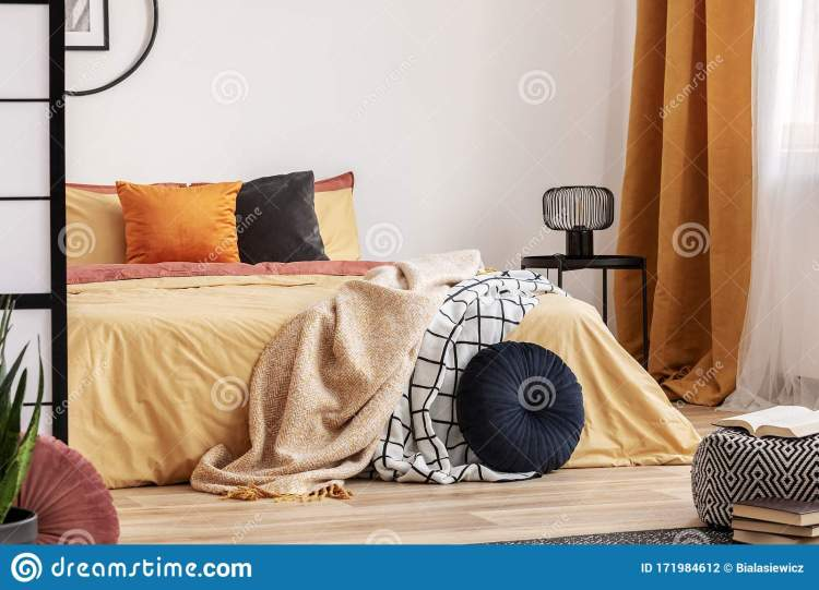Stylish Bedroom Design With Orange And Yellow Colors In Modern Apartment Stock Photo Image Of Sheets Condo 171984612