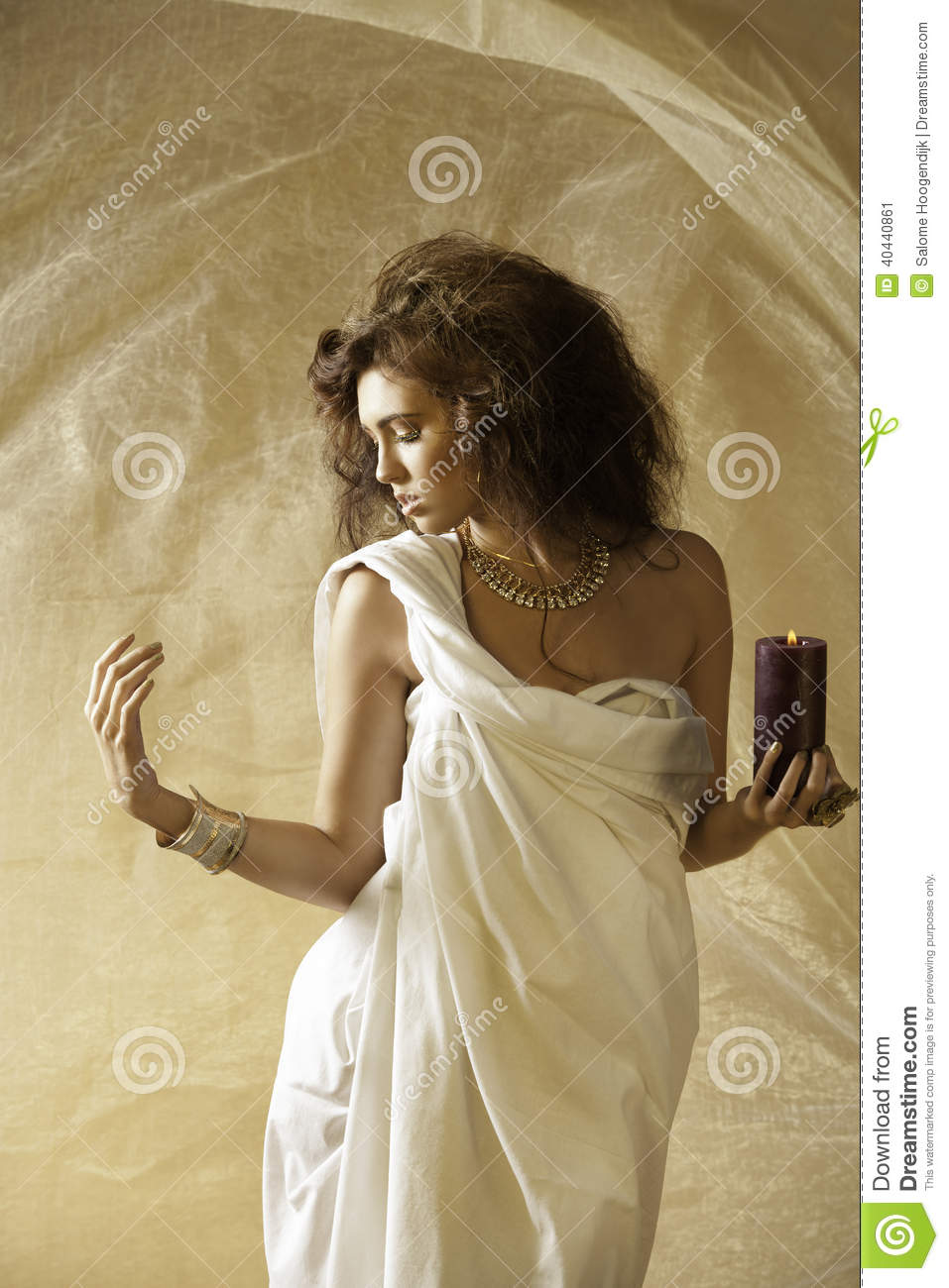 Sun Kissed Goddess With Holding A Burning Candle Stock