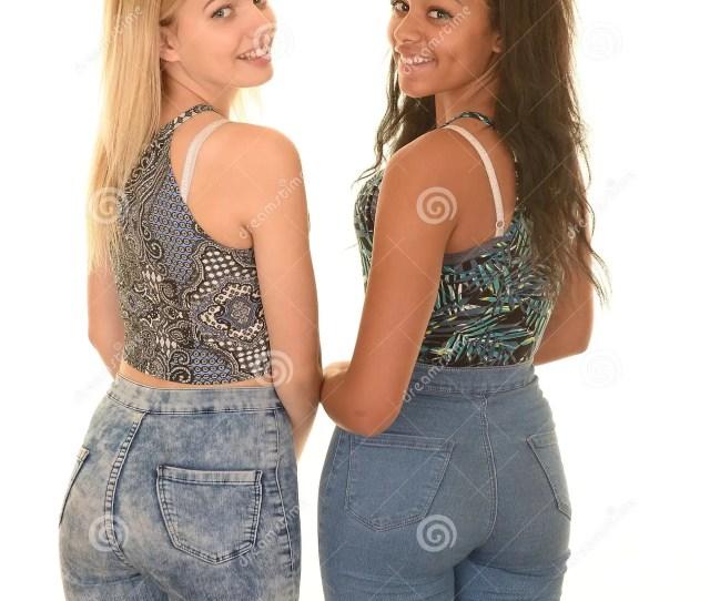 Teen Girls Posing In Blue Jeans