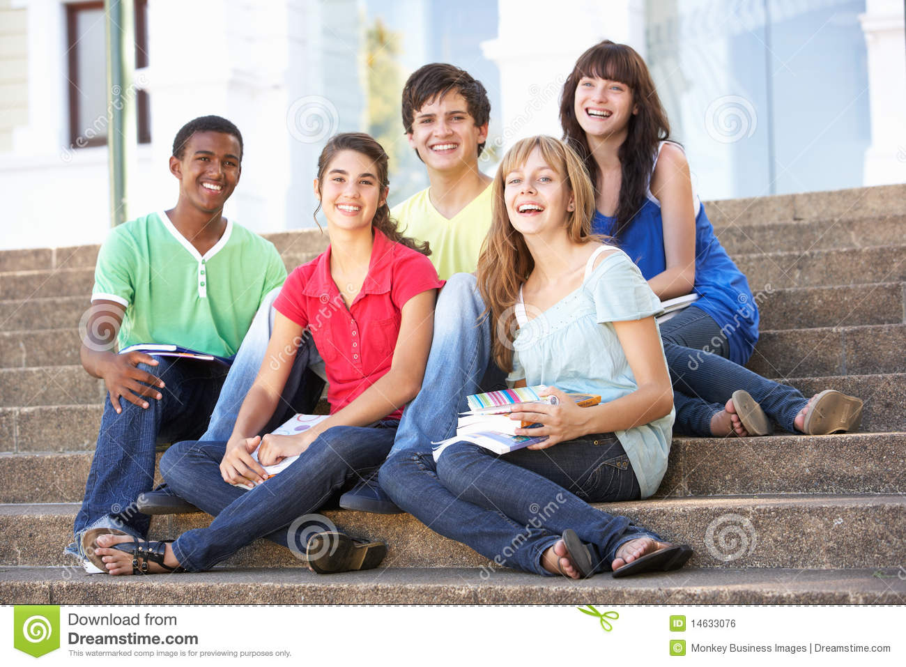 Teenage Friends Sitting On College Steps Outside Stock