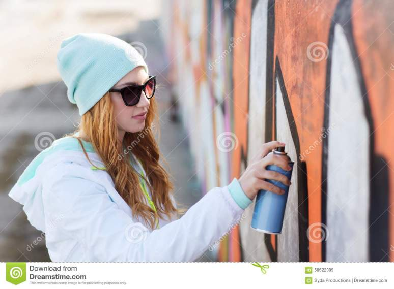 Teenage Girl Drawing Graffiti With Spray Paint Stock Photo ...