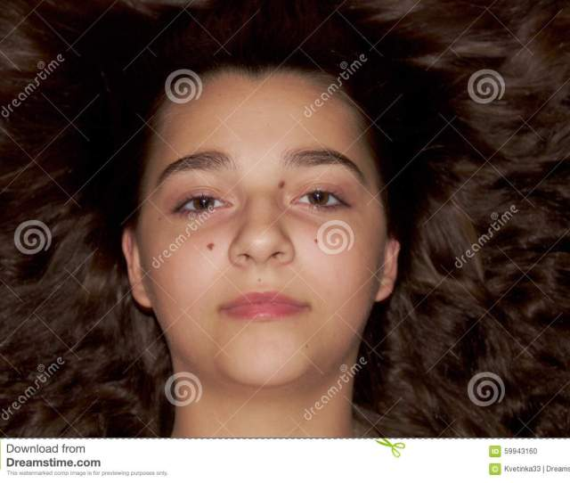 Stock Photo Teenage Girl Portrait With A Spread Hair