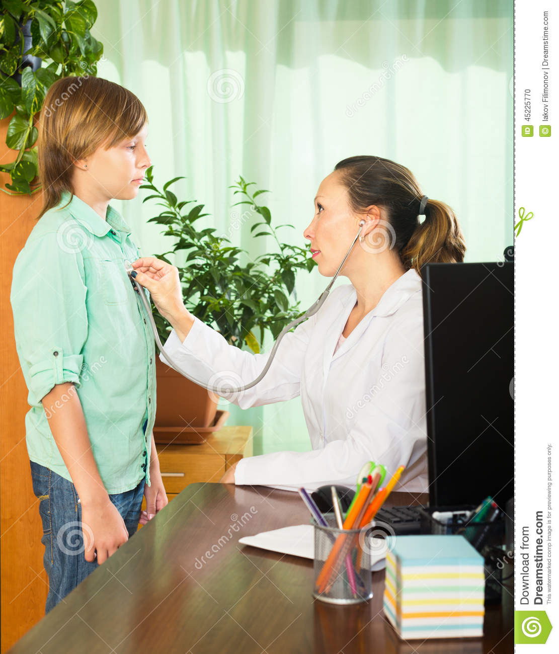 Teenager In Front Of A Doctor Stock Photo