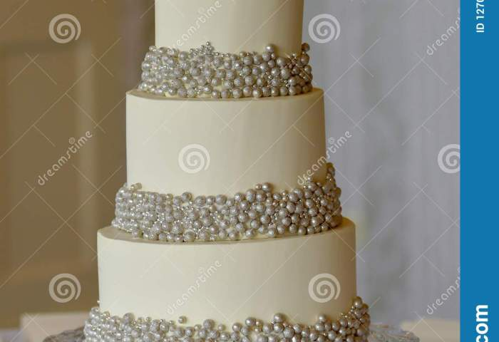 3 Tier Wedding Cake With Silver Pearls And Edible Rose Flower To