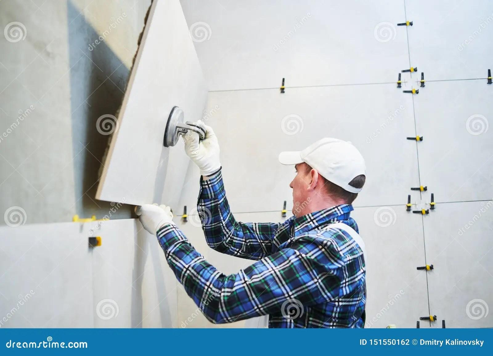 https www dreamstime com tiler installing large format tile wall home indoors renovation size ceramic image151550162