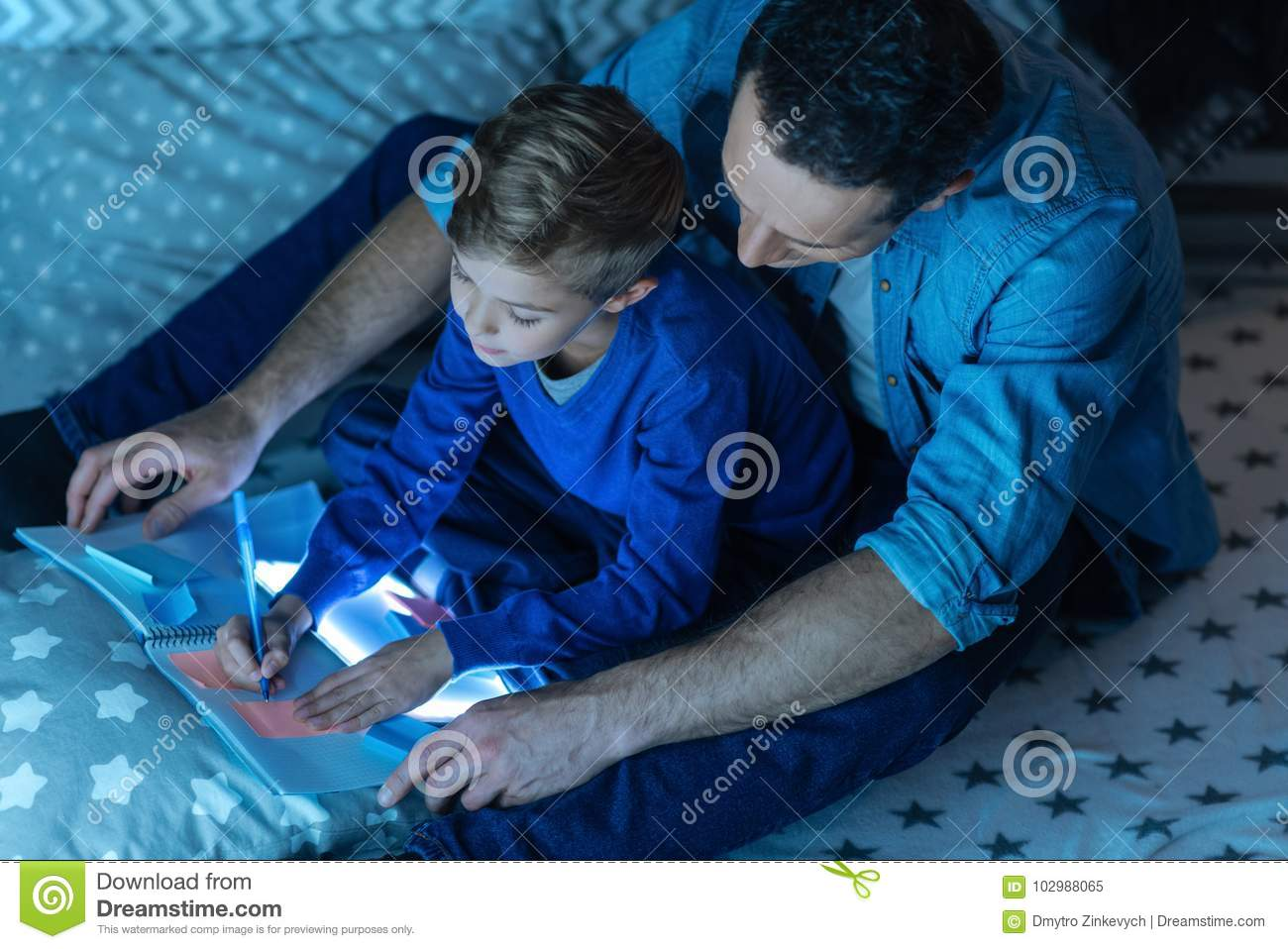 Top View Picture Of Father That Helping His Son Stock