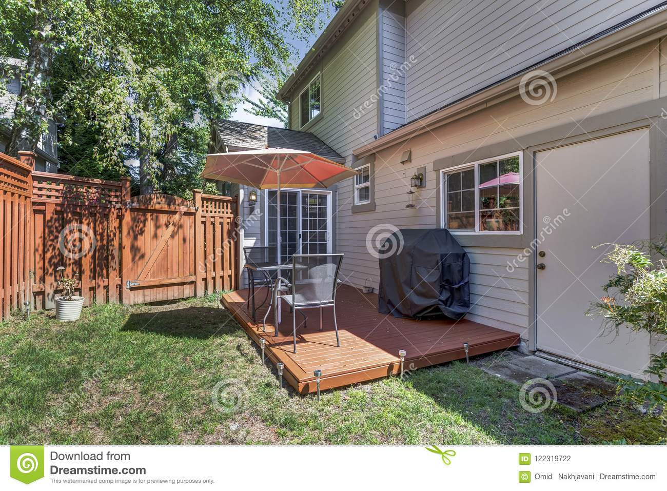 View Of A Small Backyard With Wooden Deck Stock Photo ... on Small Yard Deck id=31662