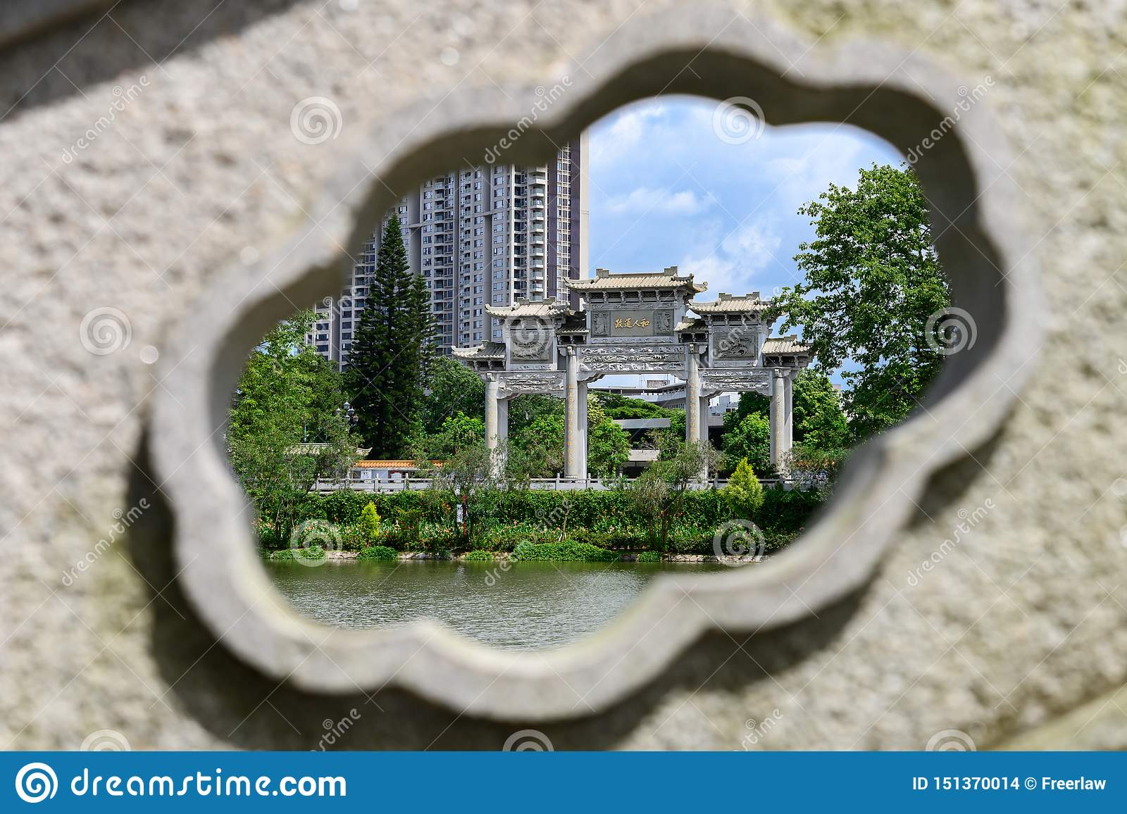 Traditional Chinese Arch Framed By Stone Carving Chinese