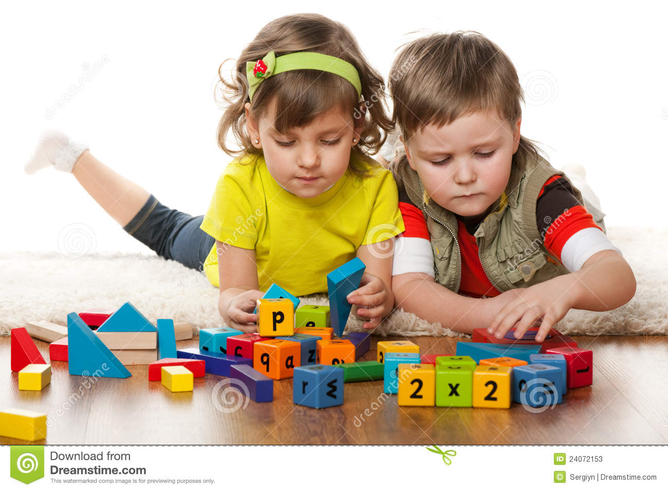 Two Children Are Playing On The Floor Stock Image