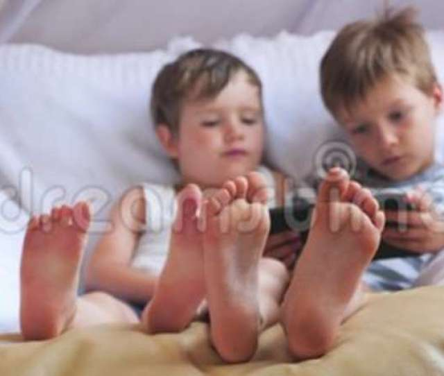 Two Cute Boys Taking A Rest At Daytime Focus On Boys Feet