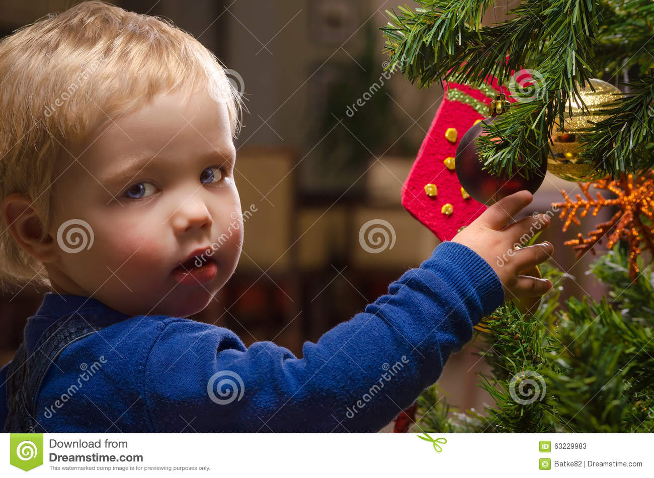 Two Year Old Boy Decorating Christmas Tree Stock Photo