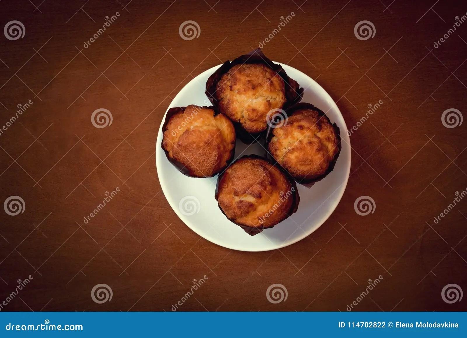 Vanilla Muffins In Paper Cupcake Holders. Stock Photo