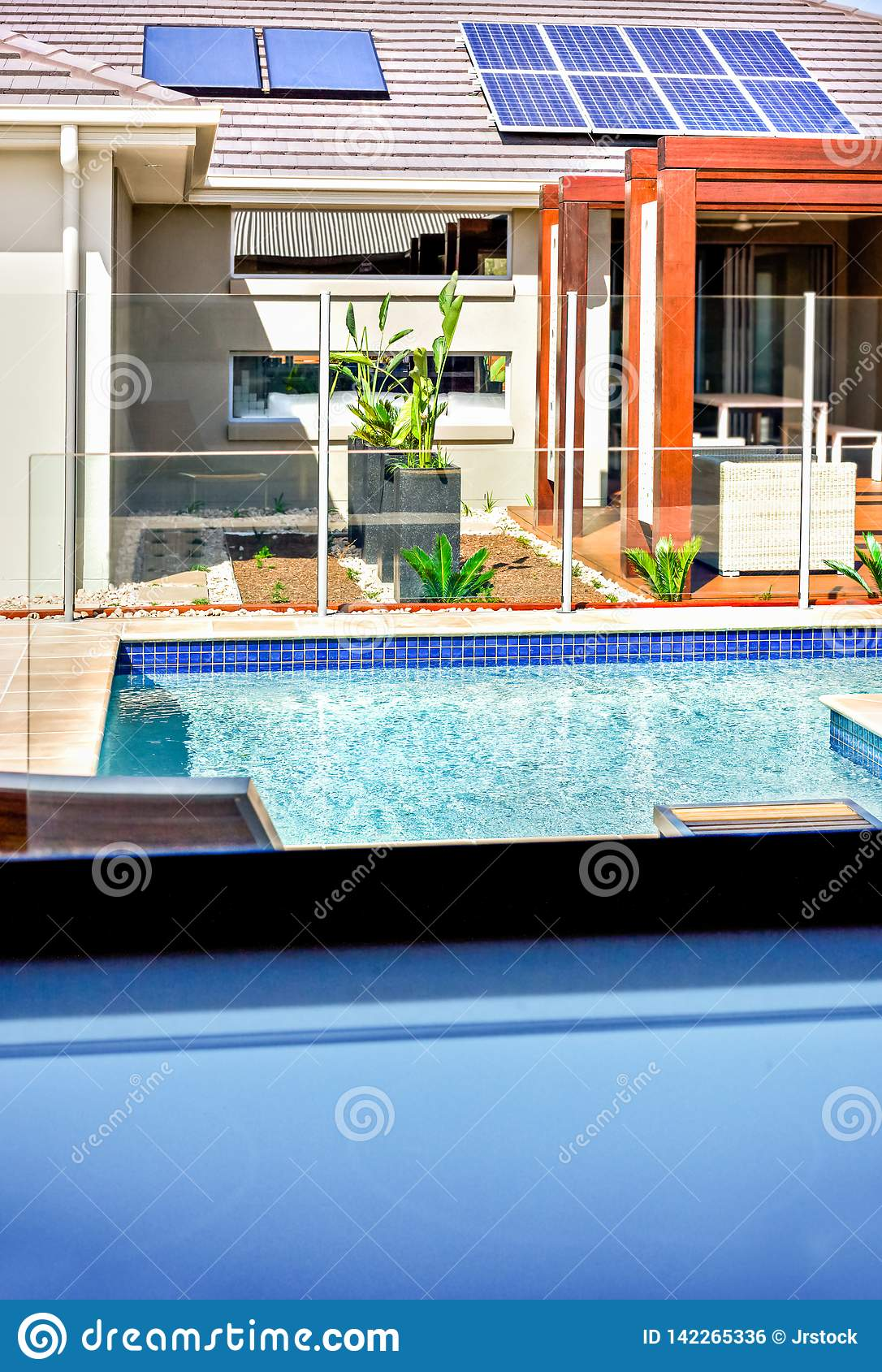 https www dreamstime com view modern swimming pool house solar panels roof patio area can be seen glass window covers chair image142265336