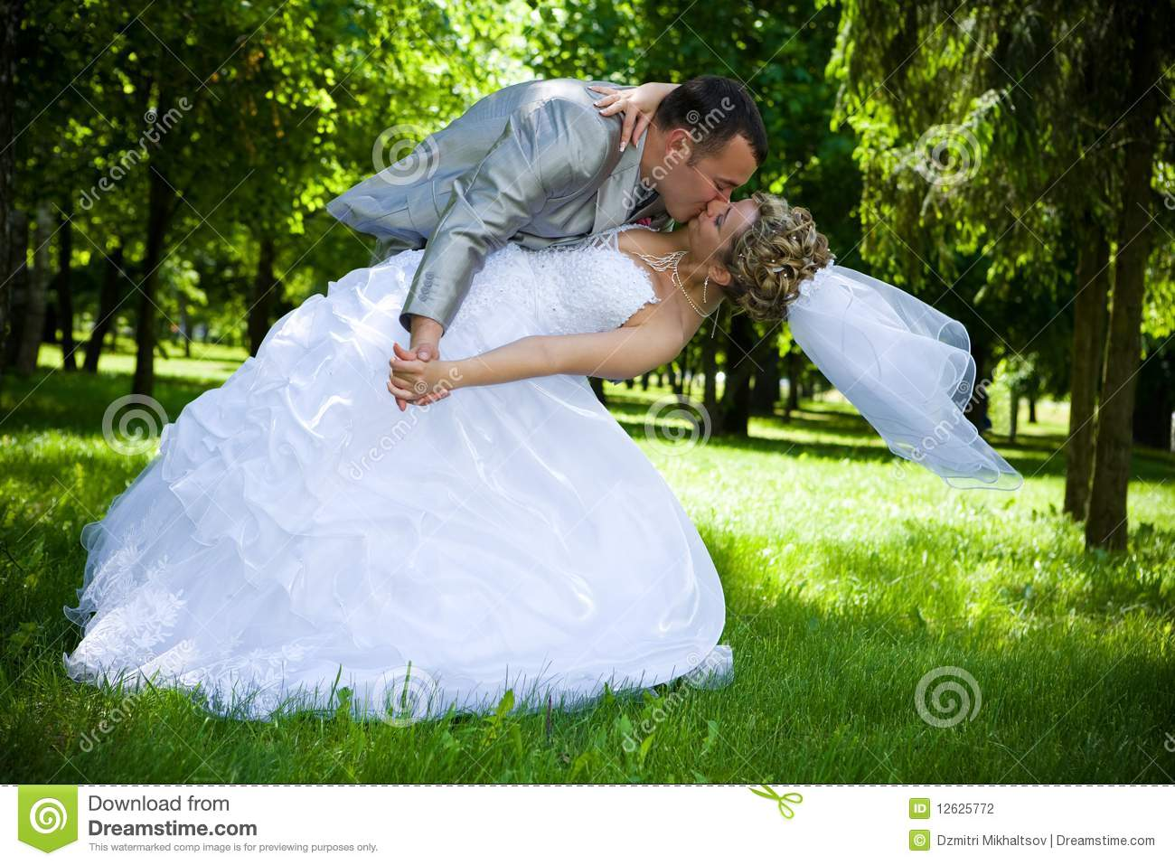 Wedding Couple Kiss In The Park Stock Photo