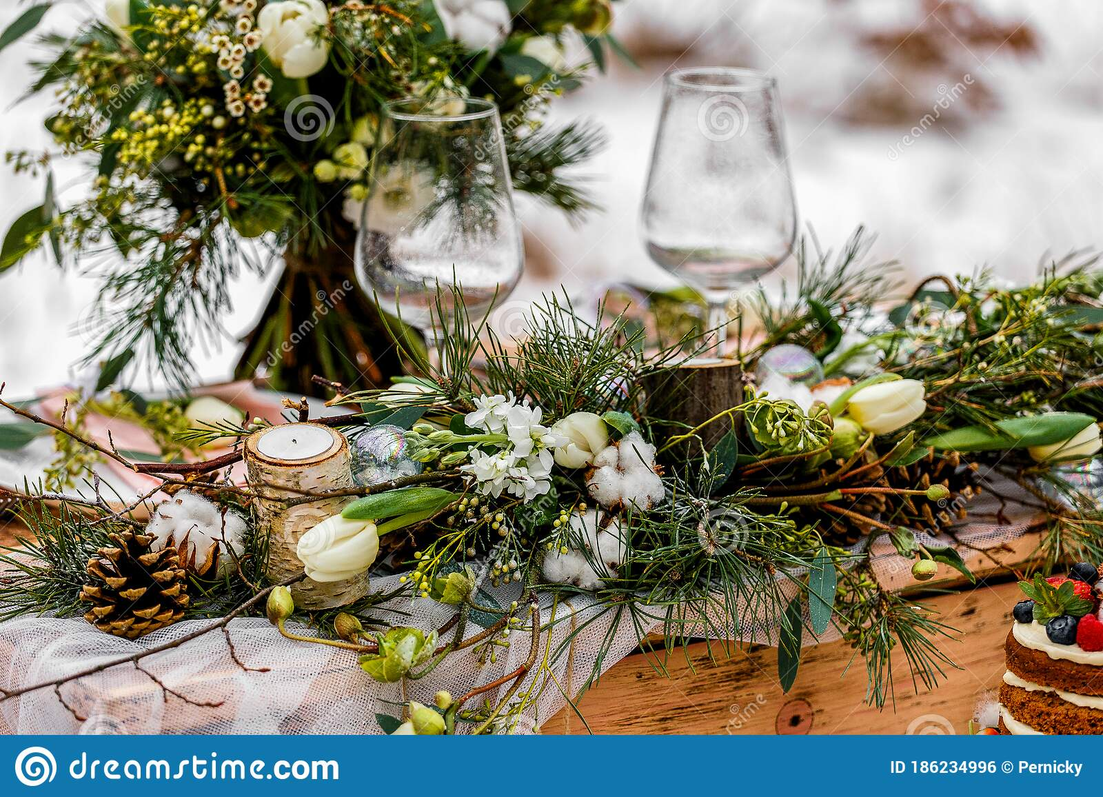 Wedding Old Wooden Table With A Flower Filled Decoration