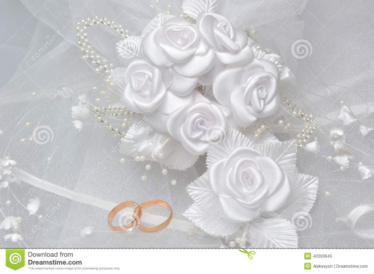 Wedding Rings On Bridal Veil With White Boutonniere On