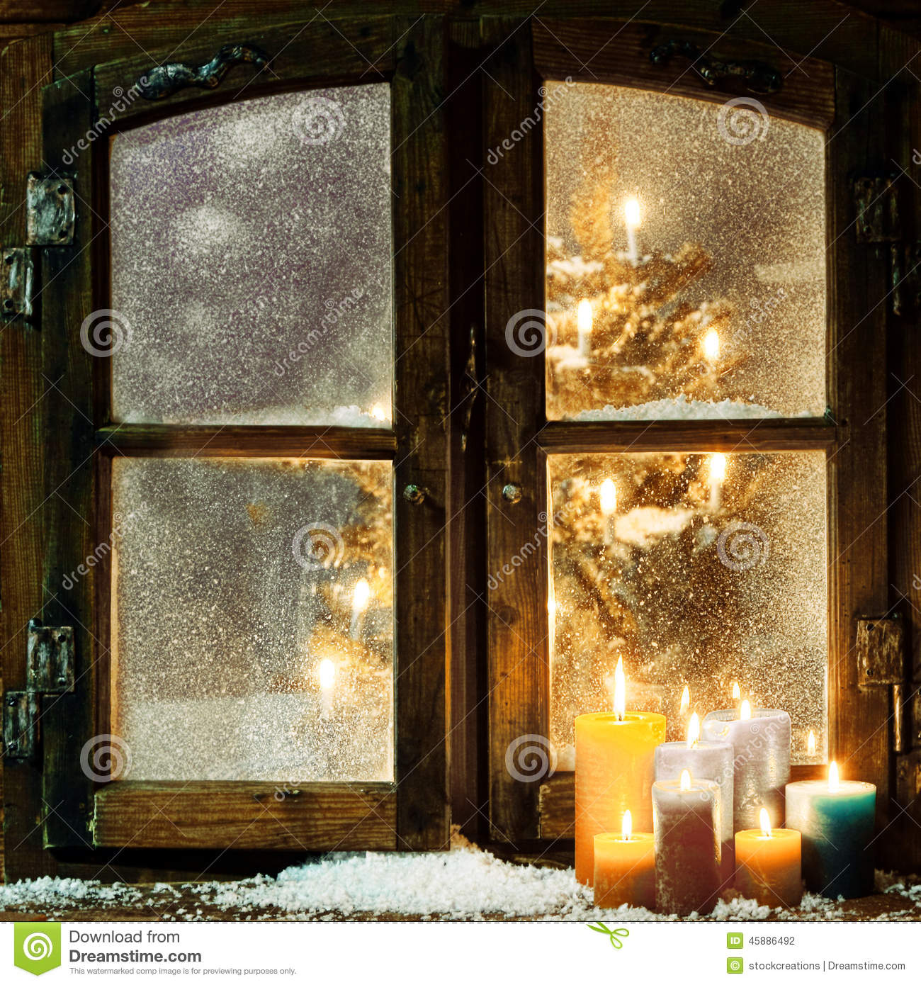 Welcoming Christmas Window In A Log Cabin Stock Photo