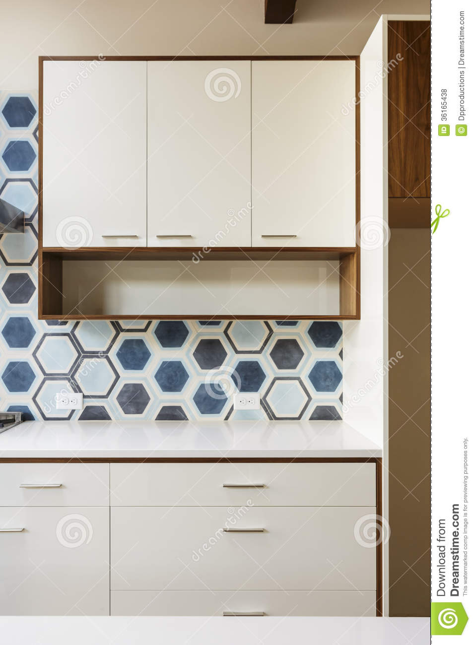 White Kitchen Cabinet In Modern Home With Blue Tile Stock