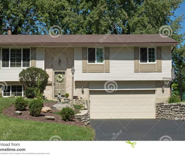 Royalty Free Stock Photo Download Tan Split Level House With Lower Garage