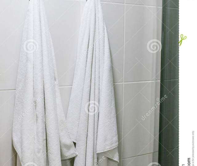 White Towels Hang On The Wall In The Bathroom Cleanliness Shower