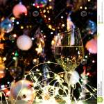 White Wine Or Champagne In Front Of Christmas Tree With Yellow Lights Stock Photo Image Of Gold Xmas 106499208