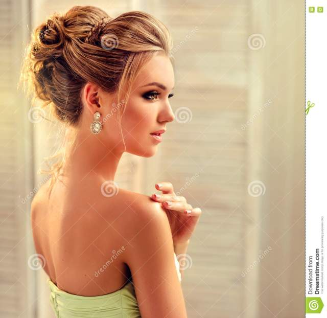 woman with blond hair, wears in a wedding gown. stock photo