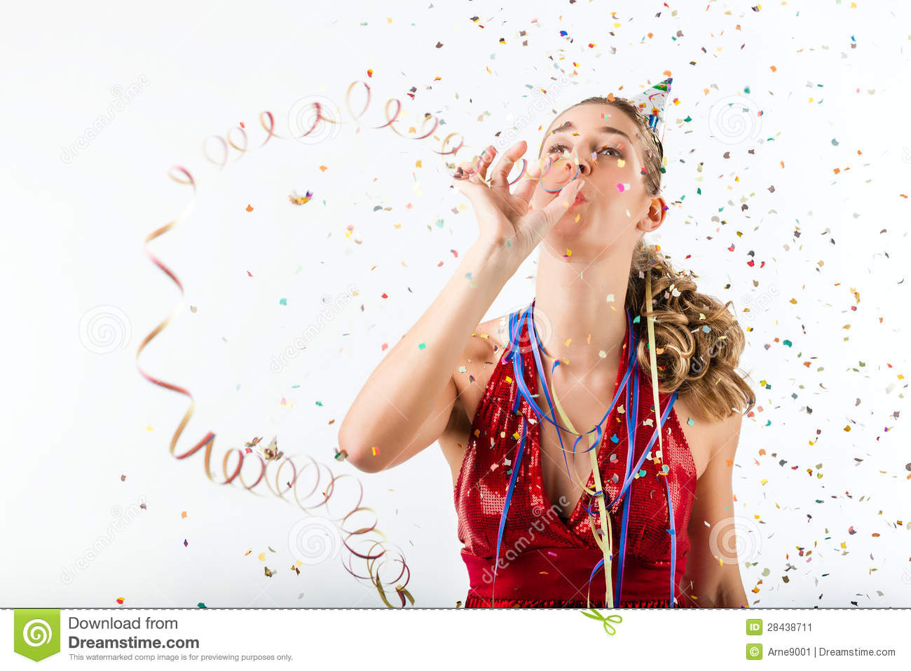Woman Celebrating Birthday With Streamer And Party Hat
