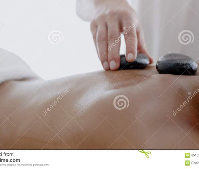 Woman Receiving A Massage With Hot Stone