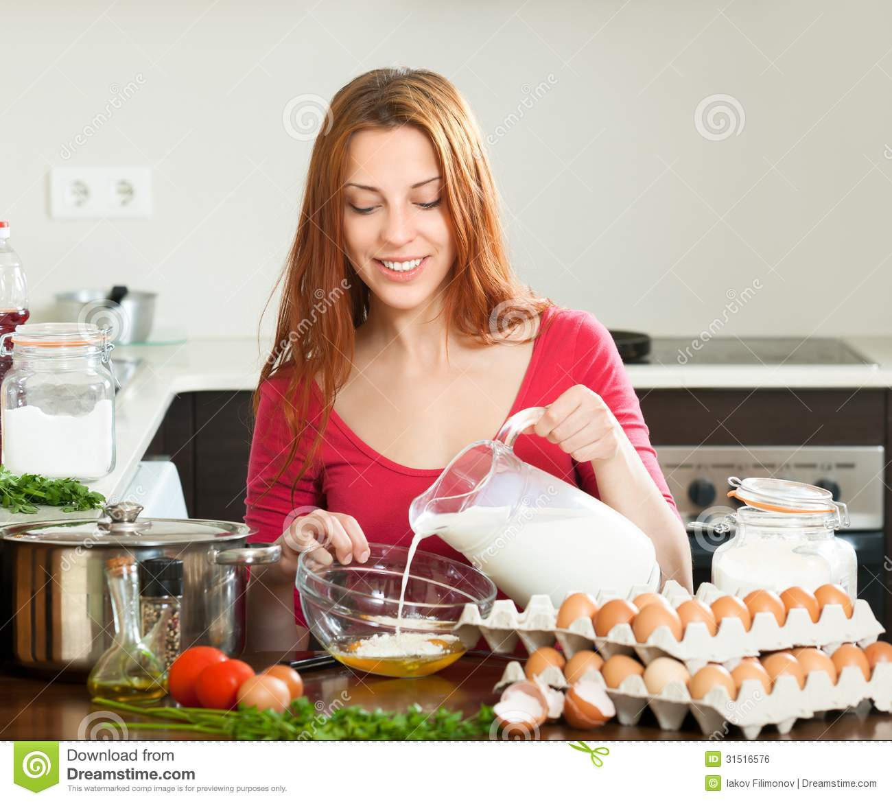 woman in red making dough or omlet in kitchen stock photo image of caucasian omelet 31516576
