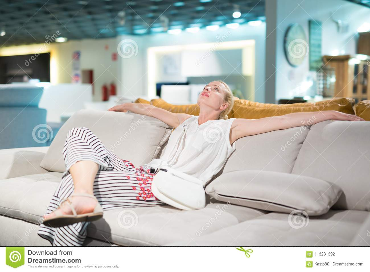 https www dreamstime com woman shopping new sofa furniture store caucasian home decor lady sitting relaxing imagining her architectural image113231392