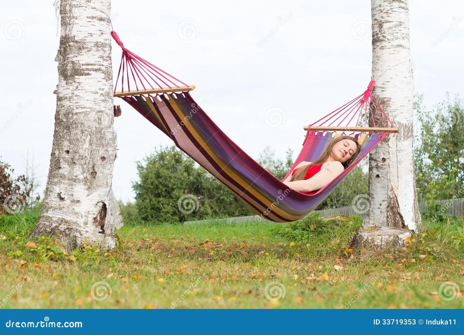 Woman Sleeping In Colorful Hammock Stock Image