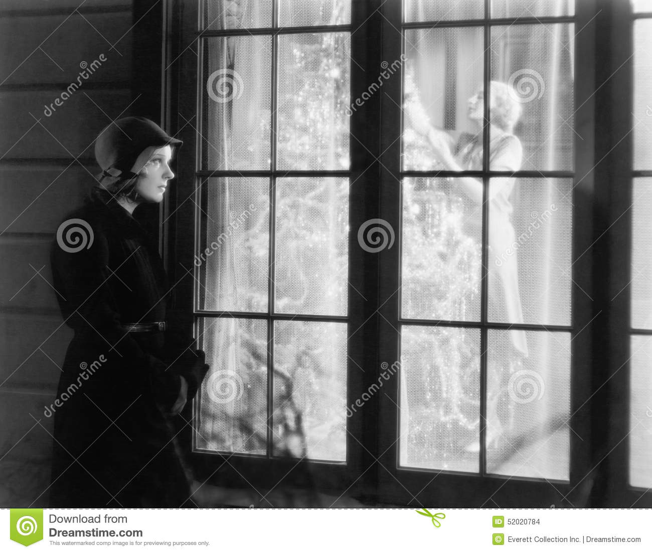 Woman Standing Outside Of A Window Watching A Woman