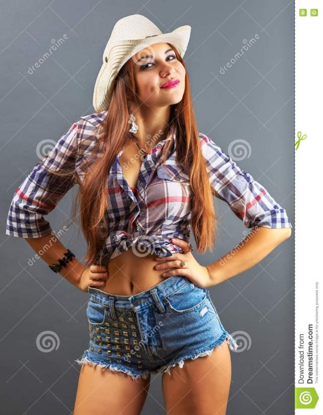 Young Beautiful Girl In Cowboy Hat