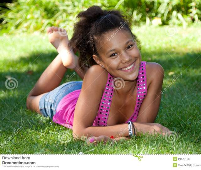 Young Black Teenage Girl Lying On The Grass