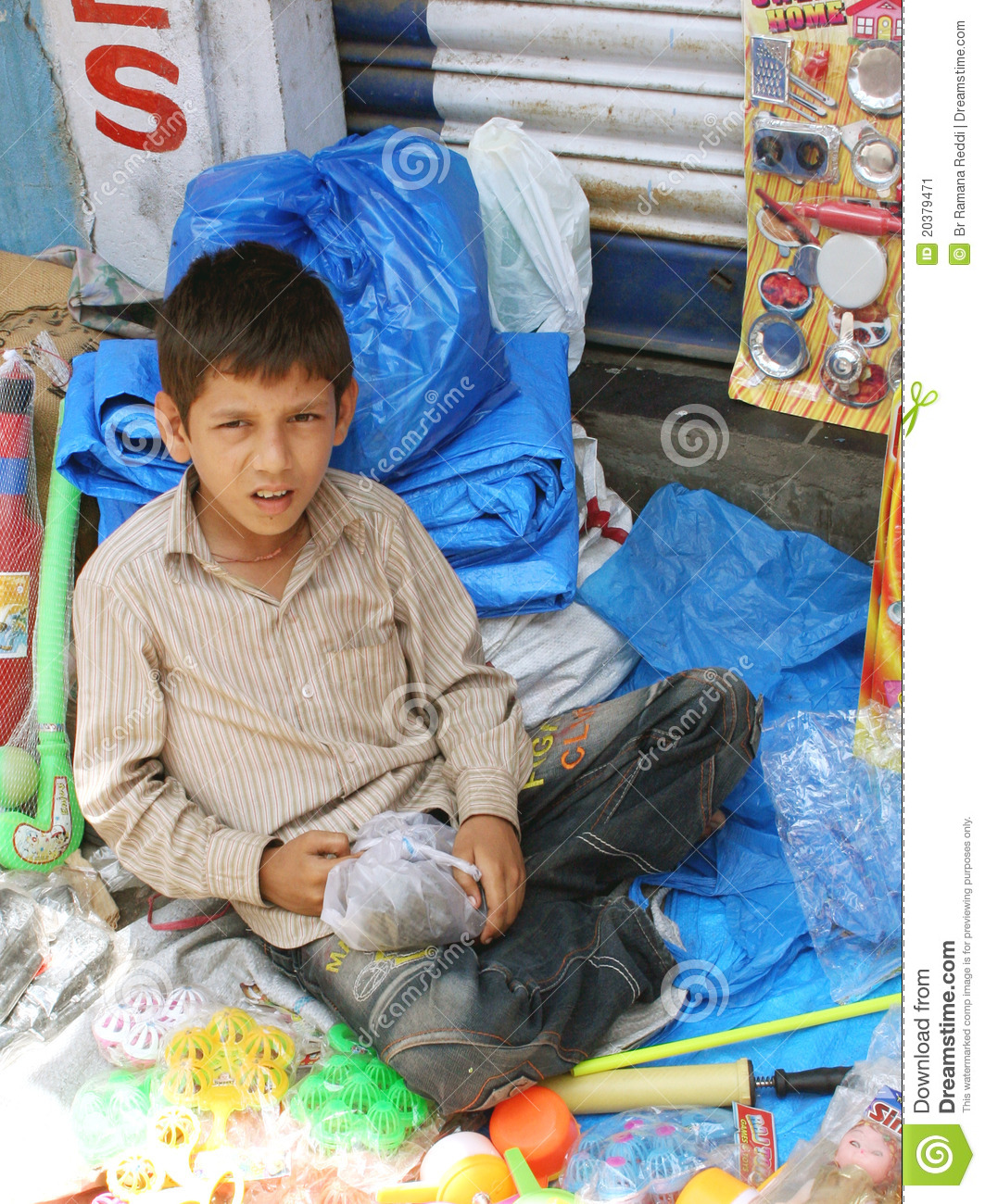 Young Boy Selling Toys On Roadside Editorial Photo