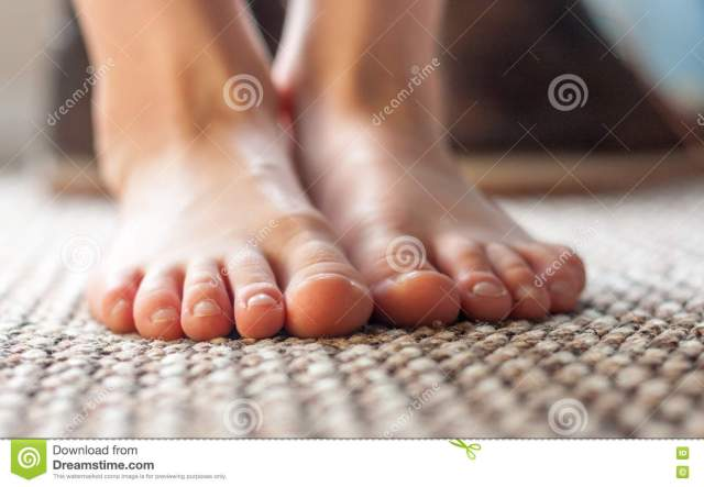Close Up Of A Pair Of Young Boys Feet