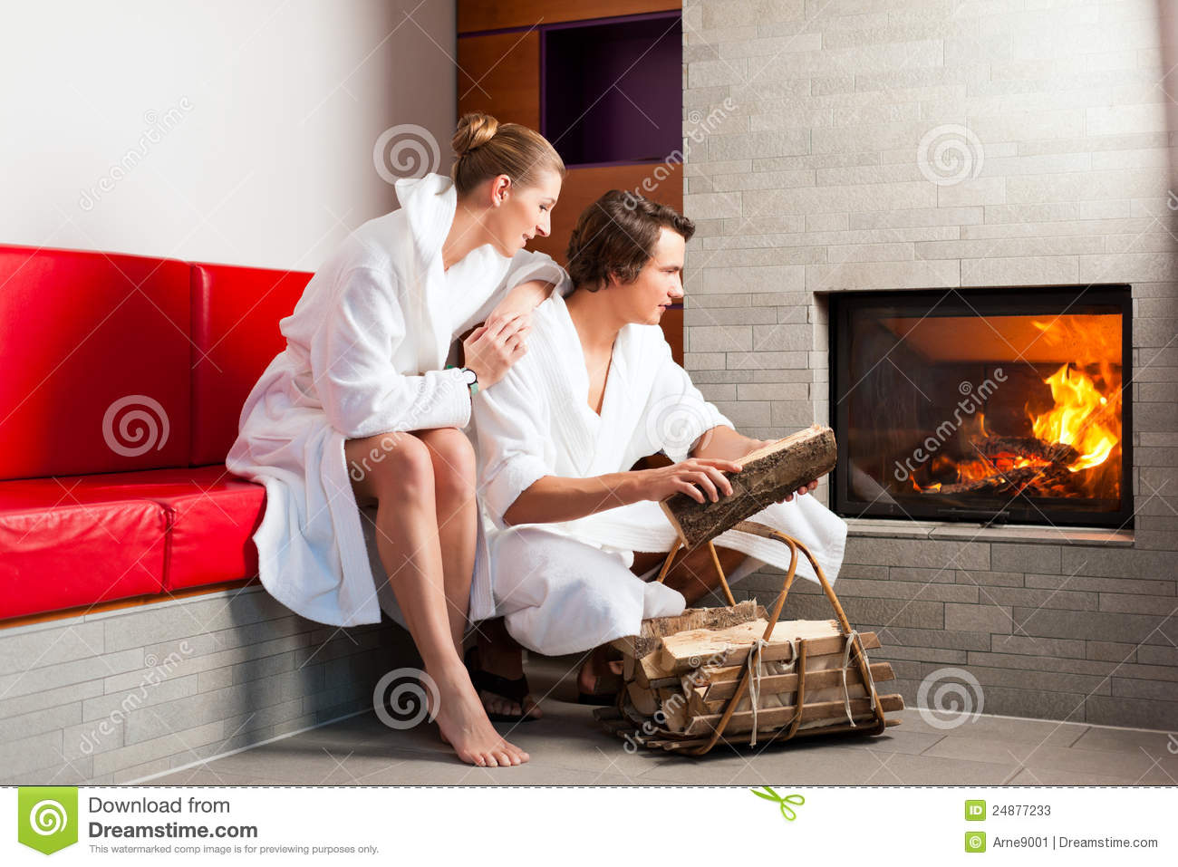 Young Couple Sitting In Bathrobe For Fire Stock Photos