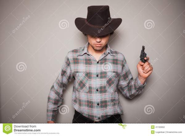 Young Cowboy With A Gun Stock Photo - Image: 41100950