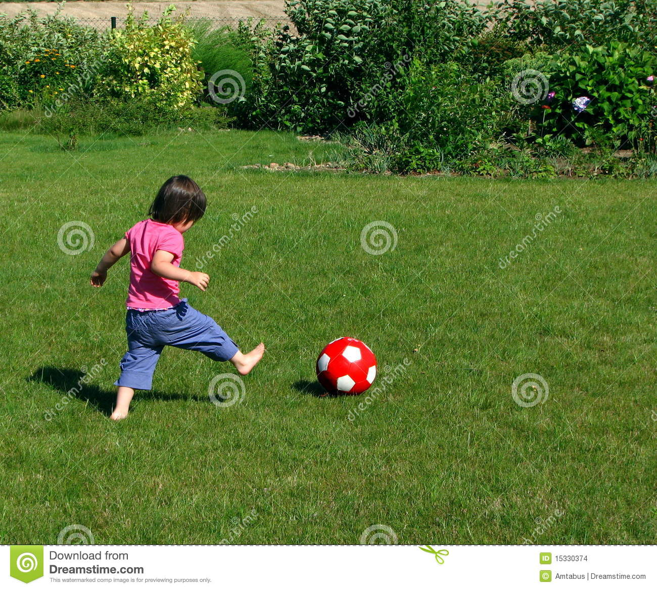 Young Girl Playing Football In The Garden Stock Images