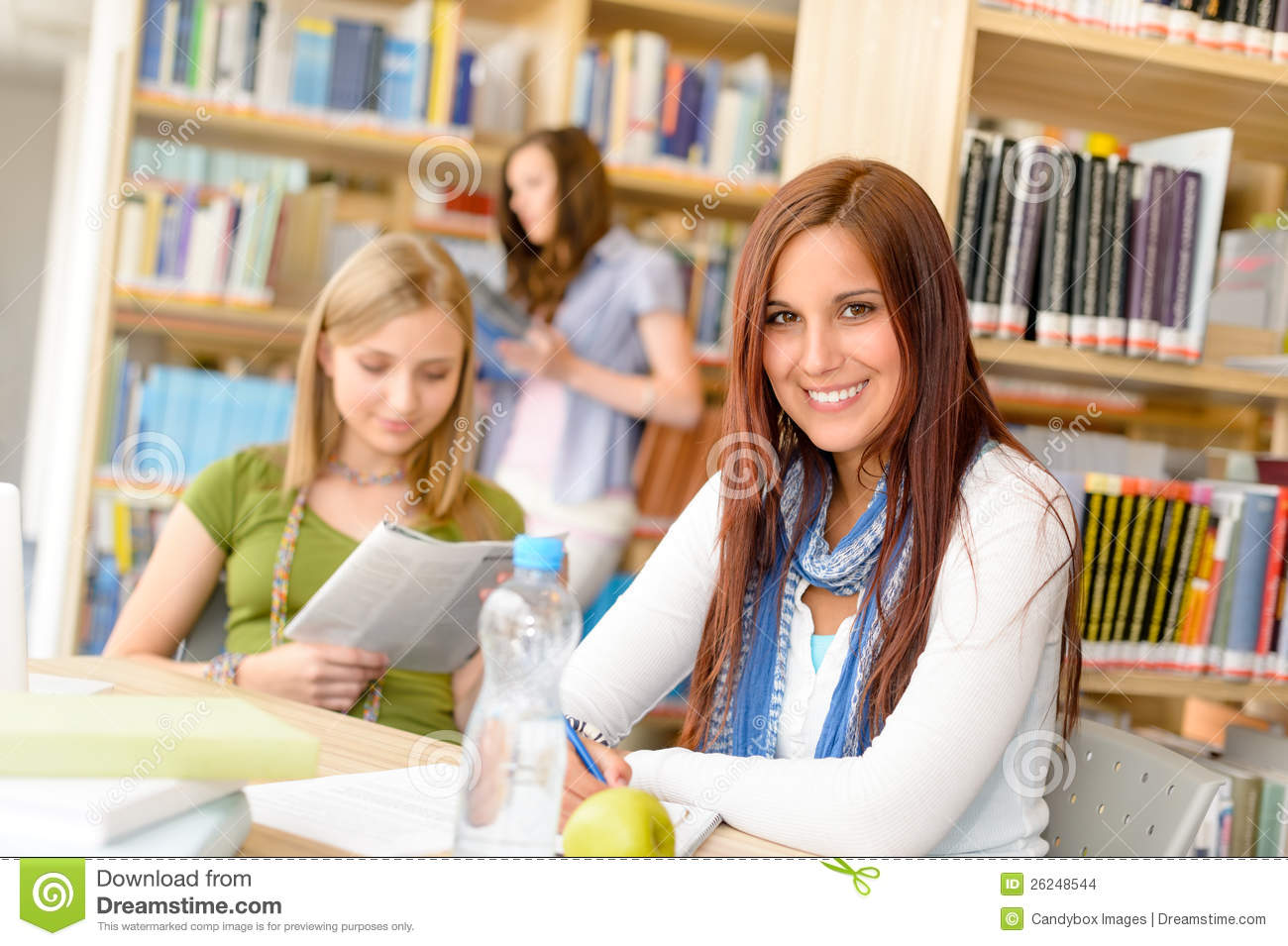 High School Students In Study Room Reading Writing Stock